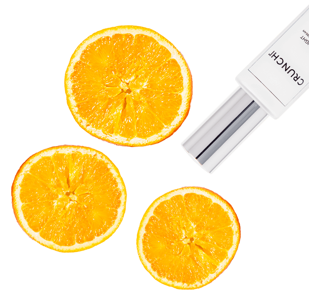 Orange halves with Daylight Facial Cream